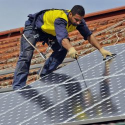 The team from PSG Elecraft install a solar unit at the Melbourne City Mission. Romie Choueiri.